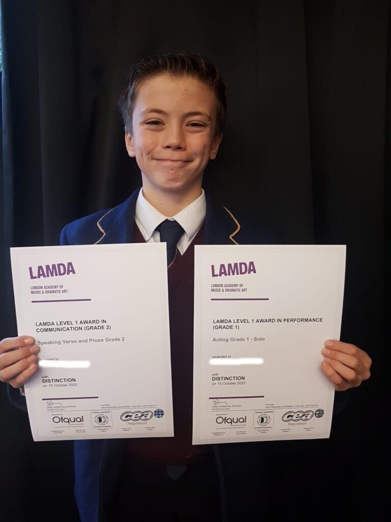 A Rookwood School pupil having completed his LAMDA.