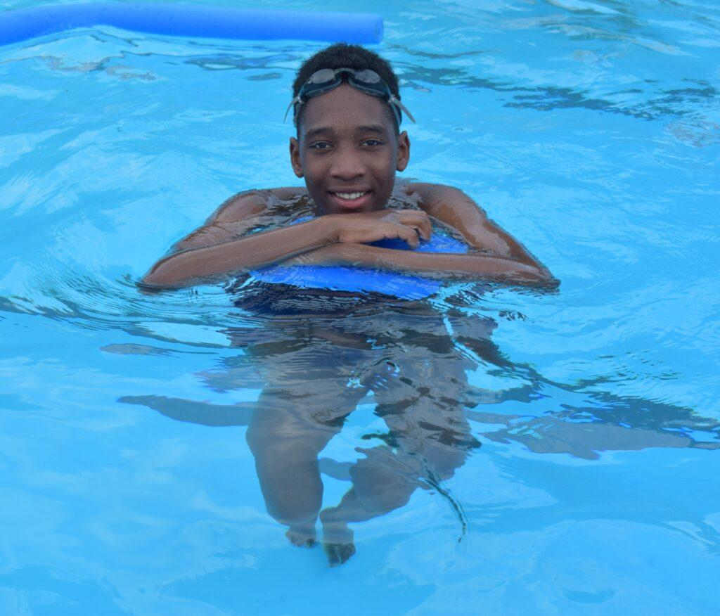 A child swimming at summer camp