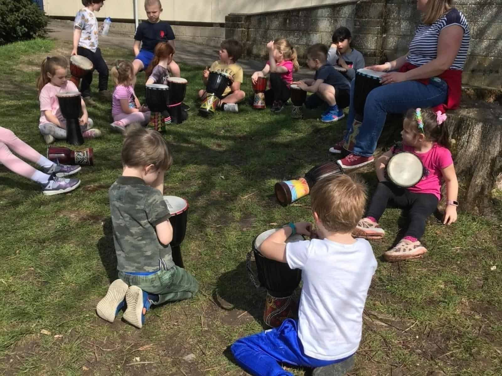 Young children enjoying outdoor activities at the summer camp