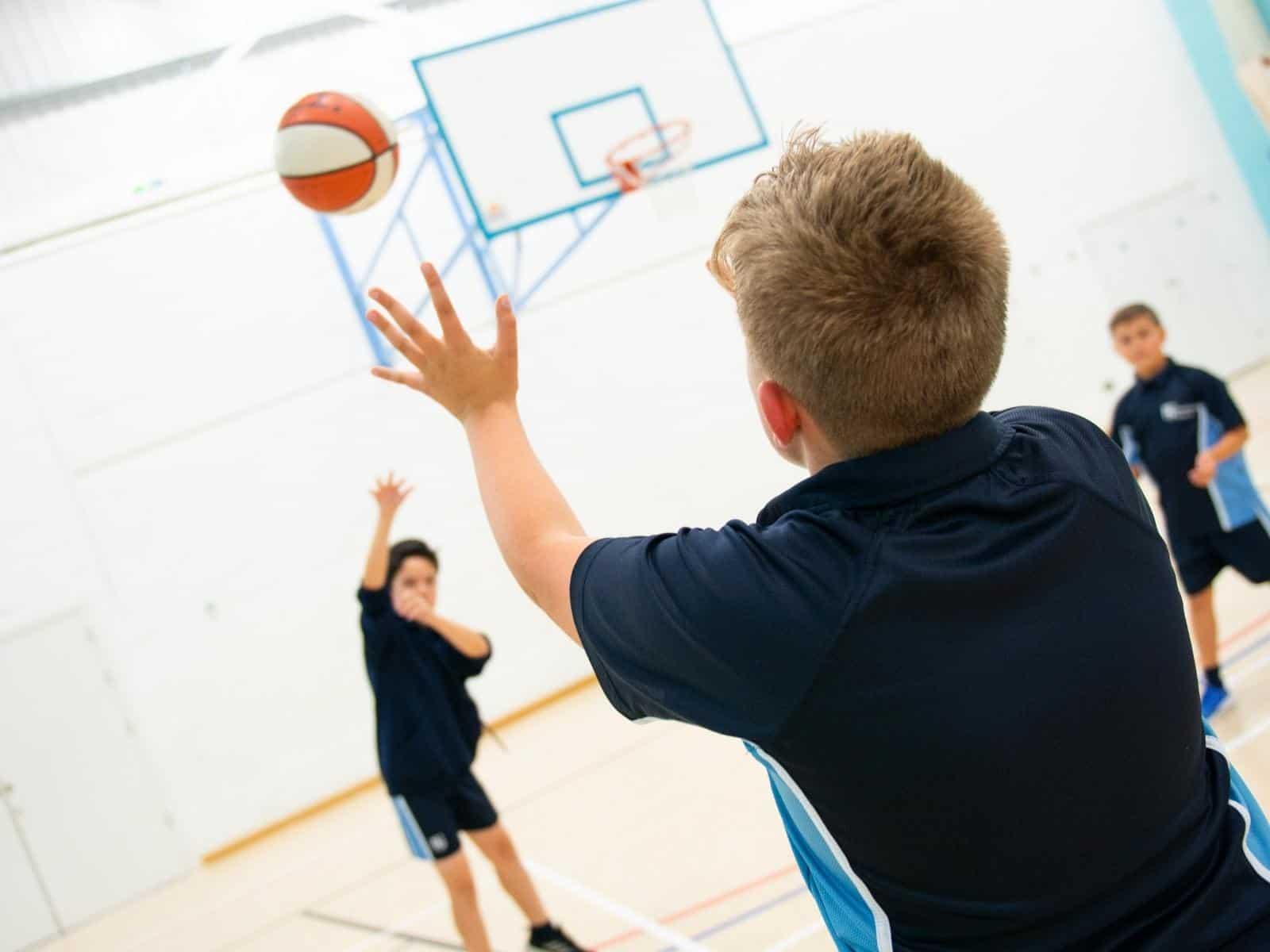 Children playing basketball at summer camp